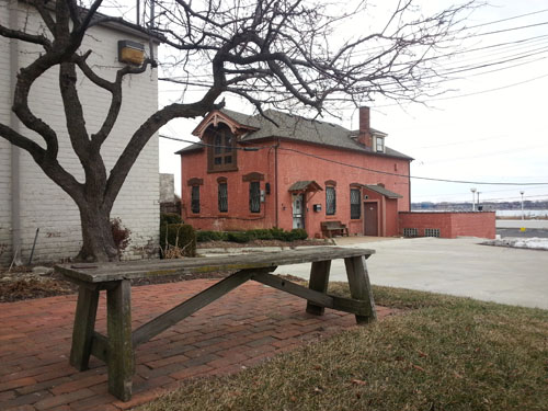 This inviting bench has a nice view of the adjacent carriage house, totally mismatched in style from the house it sits behind.